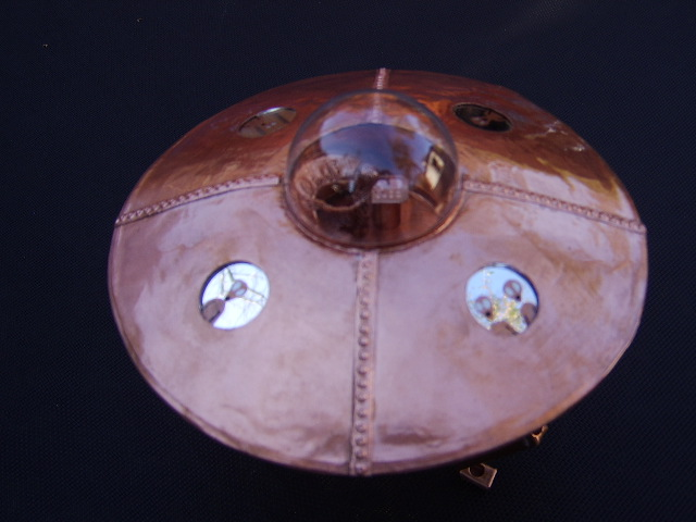 Copper Art UFO with aliens in the cockpit