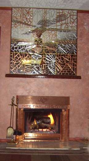 Creative Energy,Concrete fire place mantel and copper wall art.