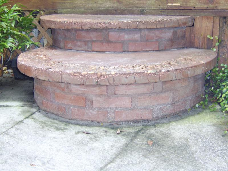 Custum concrete steps on bricks