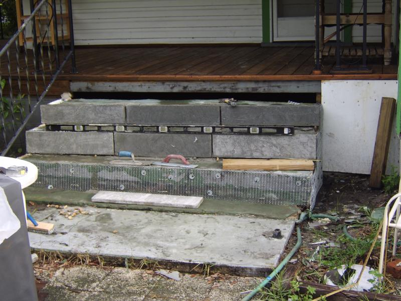 cracked and broken concrete steps in need of repair